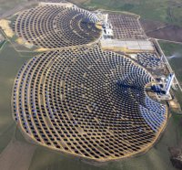 At Abengoa Solar's facility in Spain, mirrors heat a liquid in a tower