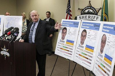 Snohomish County Cold Case Detective Jim Scharf, left, presents new images rendered using phenotype technology of a potential suspect