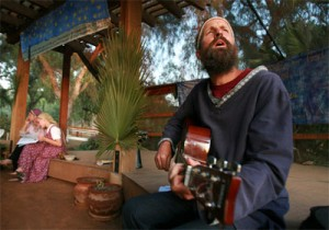 David Bekor sings and plays the guitar as he watches the sunset Friday evening at the Twelve Tribe's Morning Star Ranch