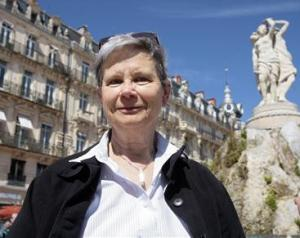 Genette Eysselinck, who renounced her U.S. citizenship to become Belgian, poses in Place de la Comedie in Montpellier