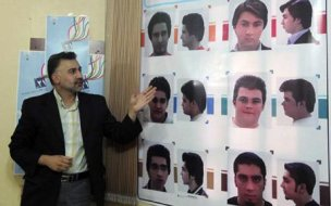 An official describes appropriate hairstyles for men at an official hairstyle show in Tehran