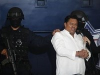 Jose Flores, 44, of Bolivia is shown to the press after his arrest