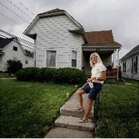 Lindsay Binegar bought this Greenfield house with her $40,000 savings, which she started building at age 4