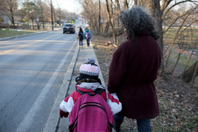 Danielle Meitiv and her daughter Dvora Meitiv, 6, walk home after being dropped off from school in Silver Spring, Maryland, Friday January 16, 2015. Danielle and Alexander Meitiv are being investigated by Child Protective Services for letting their children walk home alone from a playground.