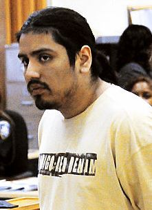 Edgar Algarin, 26, leaving his arraignment at Bronx Criminal Court for murder