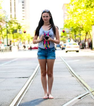 Urban hipster Carolyn LaHorgue, 17, with her grandfather's analog camera in San Francisco