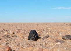 When astronomers learned that an asteroid was approaching, they prepared to track down pieces of it in Sudan. Dozens of meteorites were recovered.