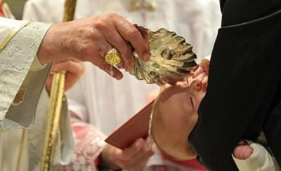 Pope Benedict XVI baptizes one of 21 newborns during in the Sistine Chapel, the Vatican