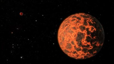 "NASA's Spitzer space telescope accidentally discovered a new planet while conducting other studies. This planet -- almost the size of Mars and covered with an ""ocean of molten rock"" -- was described by one of the space agency's scie"