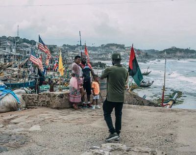 Tourists pose for pictures at the Cape Coast Castle in Ghana