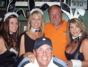 Alicia Binford (left of man in orange polo) seen dressed as a playboy bunny