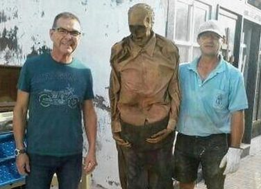 A Spanish gravedigger has been suspended after a creepy picture of him posing with an exhumed corpse went viral