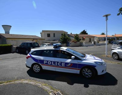 Police officers near the home of a man suspected of being the leader of a far-right extremist group on Monday in Tonnay-Charente, France