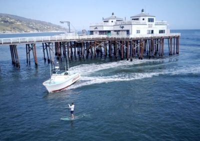 A man paddle boarding near the Malibu Pier was arrested Thursday after authorities said he disobeyed lifeguards and violated a statewide stay-at-home order amid the coronavirus pandemic