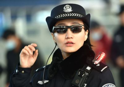 A police officer wearing a pair of smartglasses with a facial recognition system at Zhengzhou East Railway Station