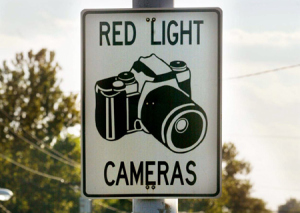 NYC uses red light cameras to rape motorists