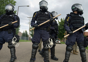 The federal government has supplied local police departments with military uniforms, weaponry, vehicles, and training