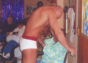 Bernice Youngblood, 85, slips a dollar bill into the briefs of a stripper