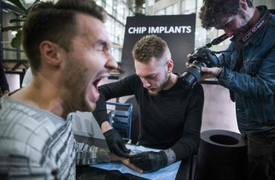A man receives his implanted microchip in Stockholm, Sweden