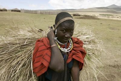 A Massai woman walks in the Ngorongoro Conservation Area