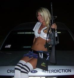 Photograph of waitress posing with sheriff's rifle